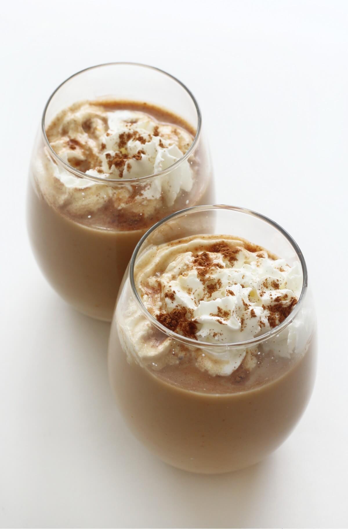 two hot keto pumpkin spice lattes in glasses