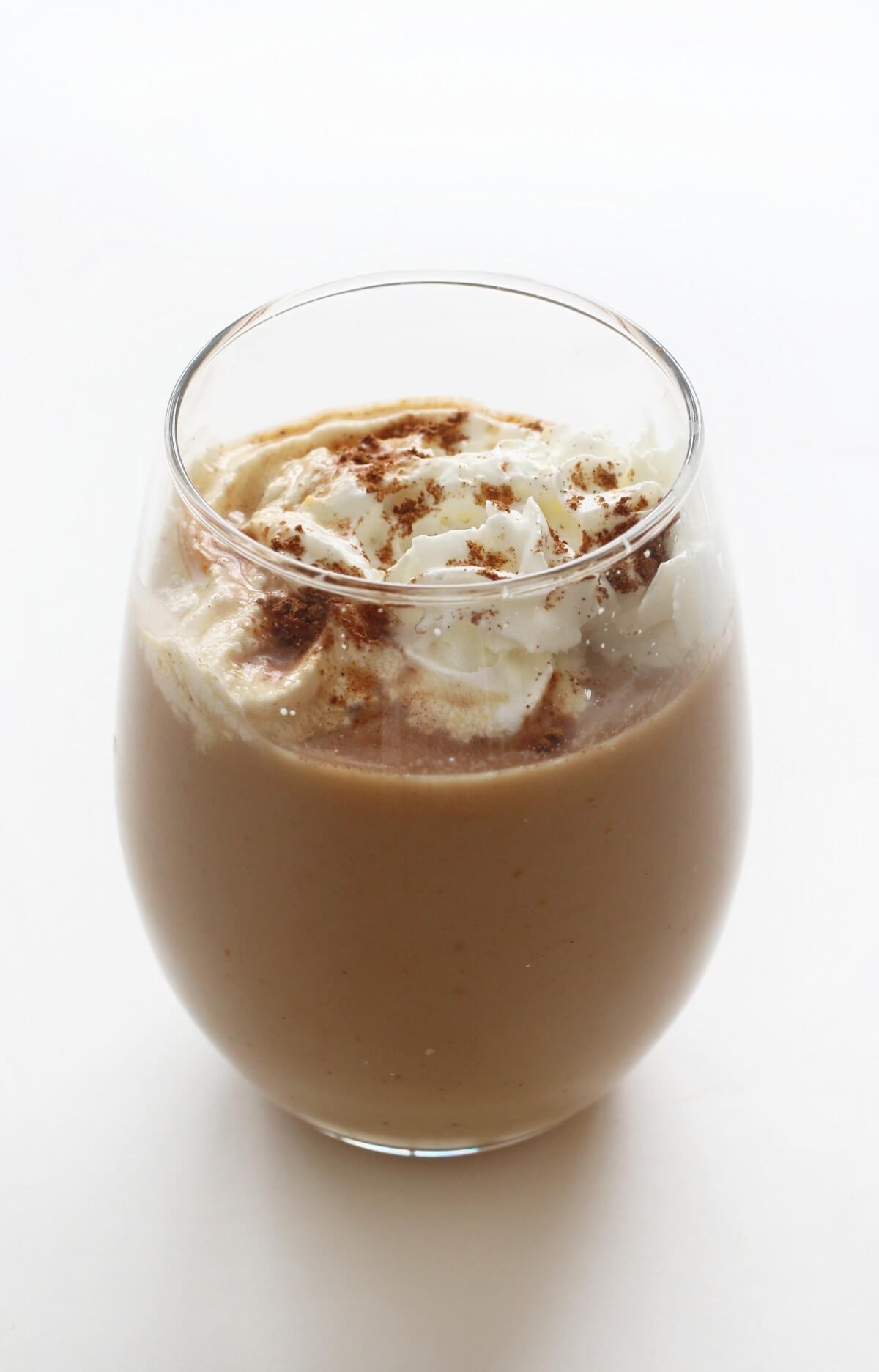 one finished hot vegan pumpkin spice latte in glass
